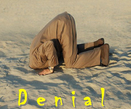 Denial CD Cover showing man with head in sand